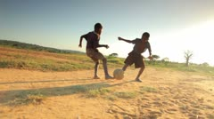 Youth playing soccer in Africa. - stock footage