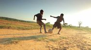 Stock Video Footage of Youth playing soccer in Africa.