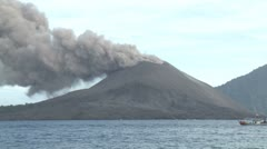 Boat Sails Past Erupting Volcano Stock Footage