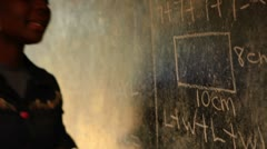 Close up of a teacher and chalkboard in Kenya. - stock footage