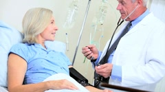 Doctor Treating Senior Female Patient - stock footage