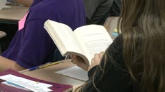 Middle school students reading in classroom. (1 of 3) Stock Footage