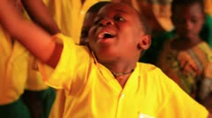 Close up of a boy raising his hand in a full classroom in Kenya. - stock footage