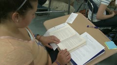 Middle school girl reading in class. Stock Footage
