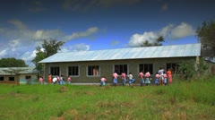 Painting the exterior of a school in Kenya. Stock Footage
