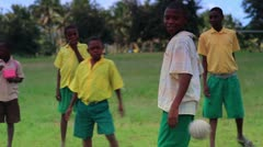 Boys playing during recess at school in Kenya. - stock footage