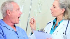 Senior Male Receiving Hospital Medical Care Stock Footage