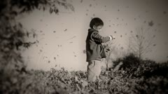 Flying leaves in autumn. Little boy. Old style. Stock Footage