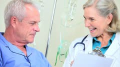 Hospital Doctor Visiting Senior Male Patient - stock footage