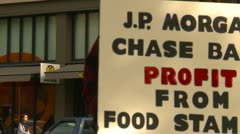 Politics and Protest, Occupy (Wall-Street) Seattle, sign JP Morgan follow Stock Footage