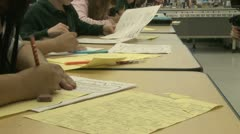 Grammar school students working on papers in classroom (8 of 11) - stock footage