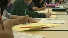 Grammar school students working on papers in classroom (10 of 11) Stock Footage