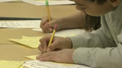 Grammar school students working on papers in classroom (11 of 11) Stock Footage