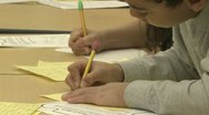 Stock Video Footage of Grammar school students working on papers in classroom (11 of 11)
