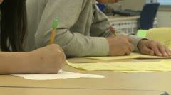 Grammar school students writing in classroom with pencils (3 of 3) - stock footage