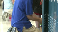 A grammar school student getting things out of locker (2 of 3) Stock Footage