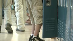 A grammar school student getting things out of locker (3 of 3) - stock footage