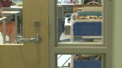 Looking in at classroom of students from hallway Stock Footage