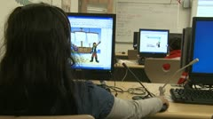 Grammar school students using computer in classroom (3 of 11) - stock footage