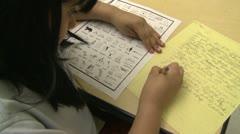 Grammar school student doing homework in classroom (1 of 6) - stock footage