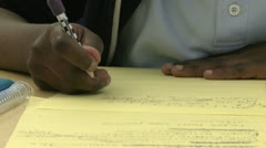 Grammar school student writing with a pencil  (1 of 3) - stock footage