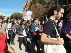 UCLA Protest Wide Angle Marching Steadicam - stock footage