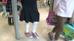 Grammar school students leaving their classroom (1 of 2) - stock footage