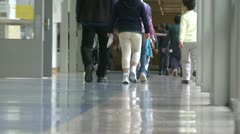 Grammar school students walking down hallway - stock footage