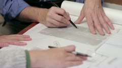 Architects sketching plans, close up on hands - stock footage