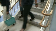 Grammar school students walking down the stairs (2 of 2) - stock footage