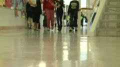 Grammar school students walking down the hall Stock Footage