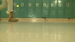 Grammar school students walking by hallway lockers (1 of 2) Stock Footage