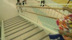 Grammar school student coming down stairway (1 of 2) - stock footage