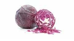 Red cabbage with cuttings on white Stock Footage