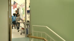 Looking into Grammar school classroom from hallway Stock Footage