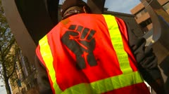 Protest, Occupy (Wall-Street) Seattle, logo on safety vest Stock Footage