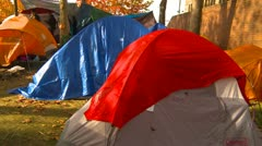 Politics and Protest, Occupy (Wall-Street) Seattle tent camp pan Stock Footage