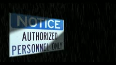 Authorized personnel sign in rain Stock Footage