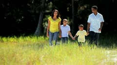 Young Ethnic Family Walking on Parkland - stock footage