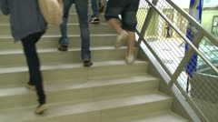Middle school students walking up stairs Stock Footage