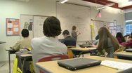 Teacher at board in front of class (4 of 5) Stock Footage