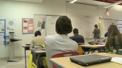 Teacher at board in front of class (2 of 5) - stock footage