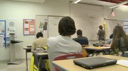 Stock Video Footage of Teacher at board in front of class (2 of 5)