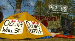 Protest, Occupy (Wall-Street) Seattle tent camp and signs, establishing shot Stock Footage