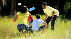 Little Ethnic Boy Practicing Baseball with his Family Stock Footage