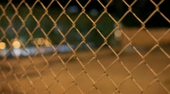 Video of a chainlink fence at night Stock Footage