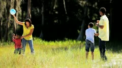 African American Family in Park Playing Ball Stock Footage