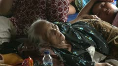 Stock Video Footage of Old Woman Sleeps In Refugee Camp During Merapi Volcano Eruption