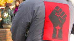 Politics and Protest, Occupy (Wall-Street) Seattle logo jacket Stock Footage