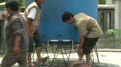 Men Wash Feet At Refugee Camp Merapi Volcano Crisis Stock Footage